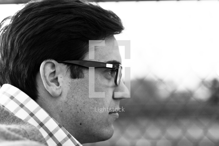 White male wearing glasses