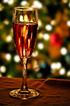 A glass of wine with bokeh background.
