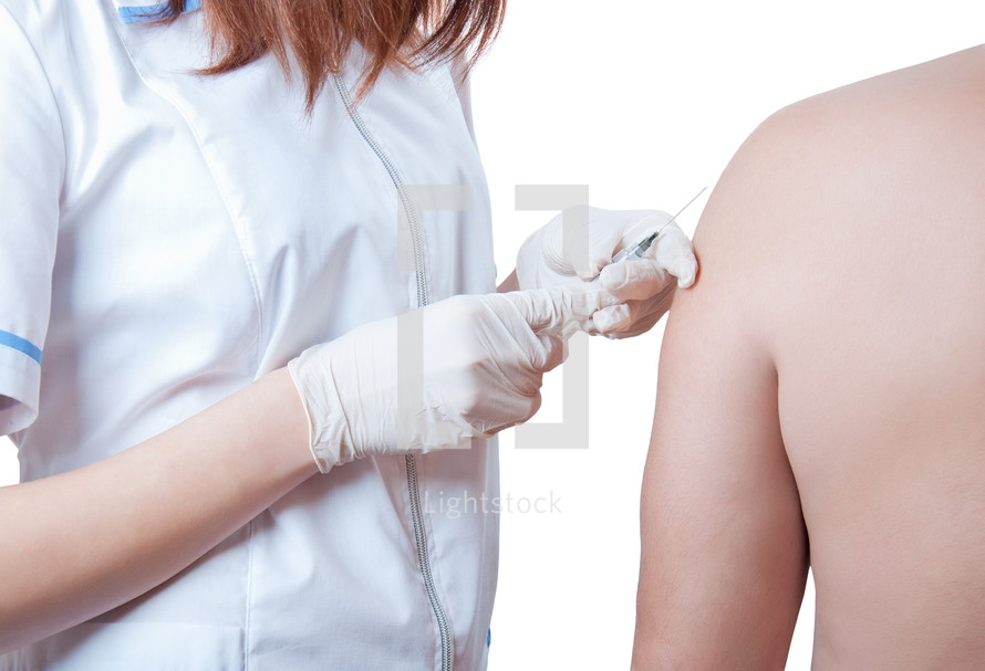 Nurse administering a vaccination.