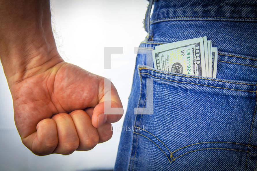 money in a man's pocket
