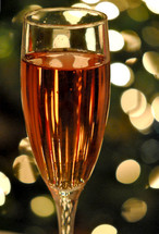 A glass of wine with bokeh background