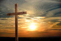 wood cross at sunrise
