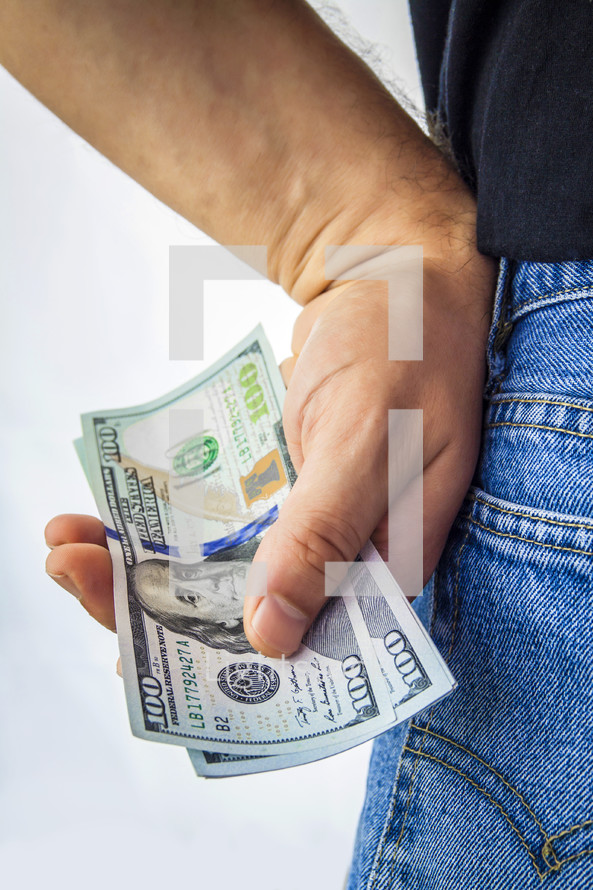 man holding a large amount of cash