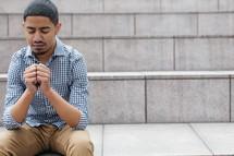 man sitting in prayer