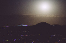 moonlight over the suburbs at night