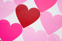 Rows of hearts in shades of pink and red.
