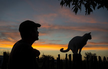 silhouette of a man and his cat