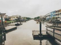 boat docks along a channel