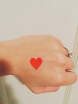 heart sticker on a hand