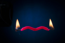 burning both ends of a candle
