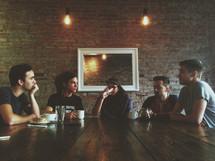 friends talking over breakfast