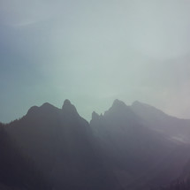 an iphone capture of the hazy mountain peaks, extra texture added