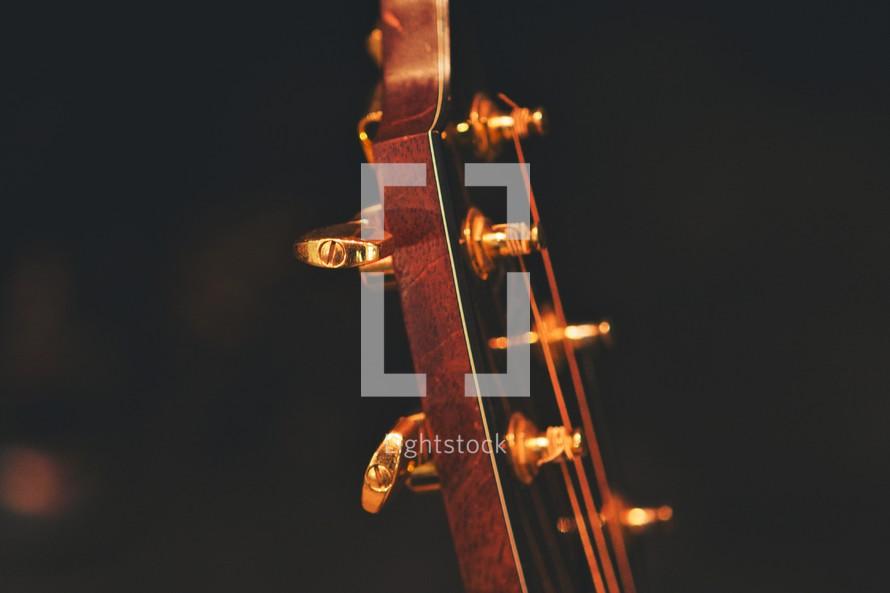 Head of a guitar.