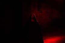 A red light shining on an actor portraying Jesus in the Passion Play.