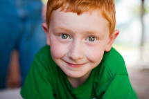 little boy with red head and green eyes