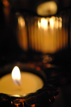lighted candles in glass holders