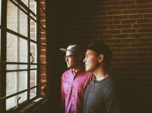 men looking out of a window