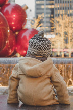 toddler boy in a winter coat and hat