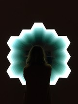 woman looking out a honeycomb shaped window