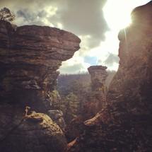 sunlight shining on a rocky cliff