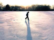boy child walking in snow
