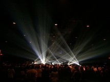 spotlight on stage and an audience at a concert