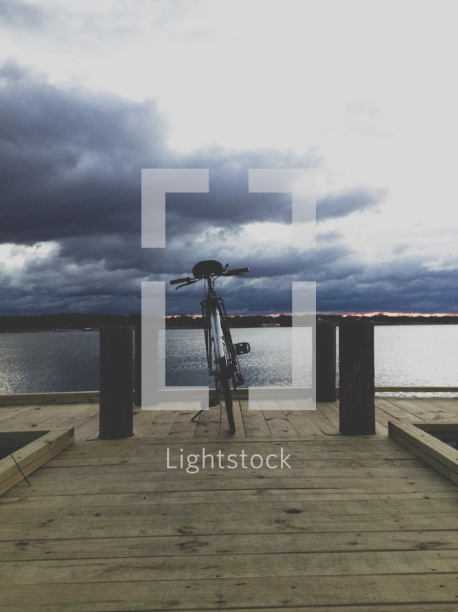 bike parked on a pier