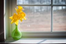 Flowers in the window sill.
