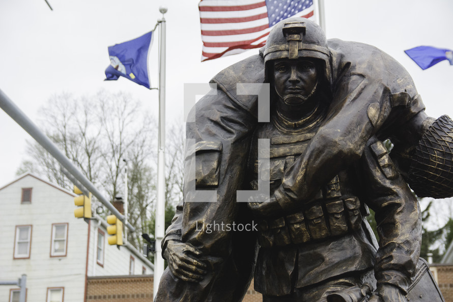 statue of a soldier carrying a fallen soldier