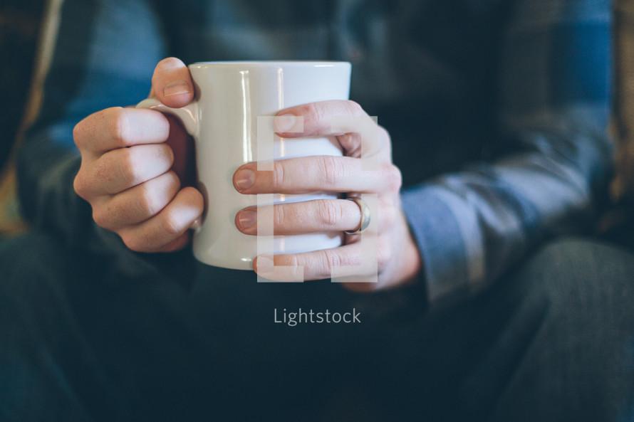 man drinking a coffee