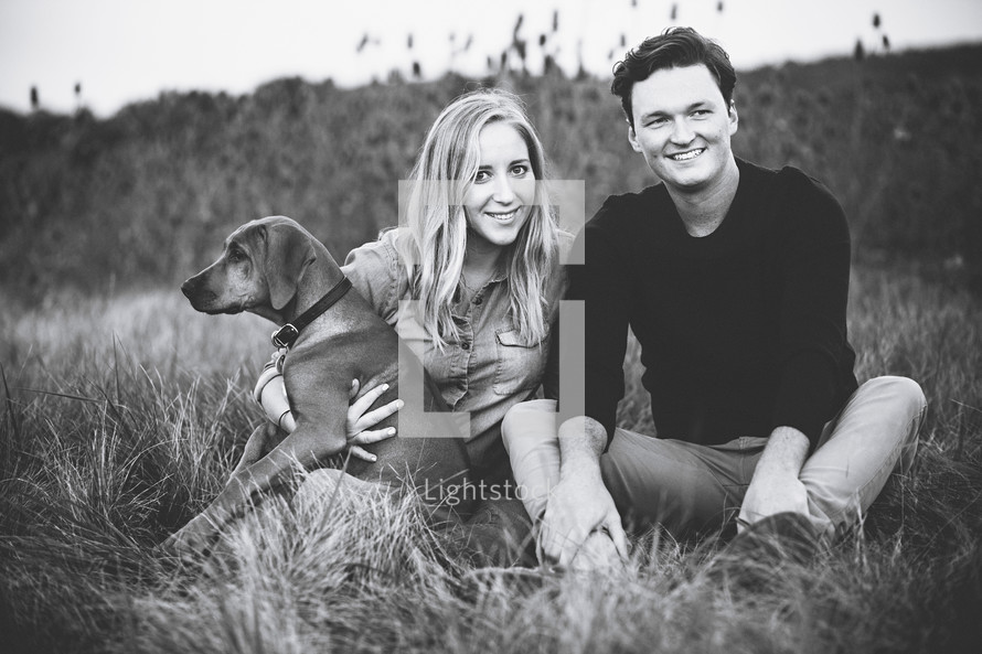 portrait of a couple with their dog