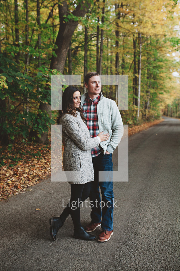 a couple standing on a rural road