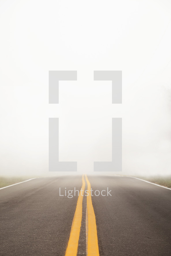 center lines on a road with fog