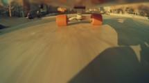Skateboard rolling through a skateboard park. Skateboarding | Youth | Under Board Shot | Skating | City | Park