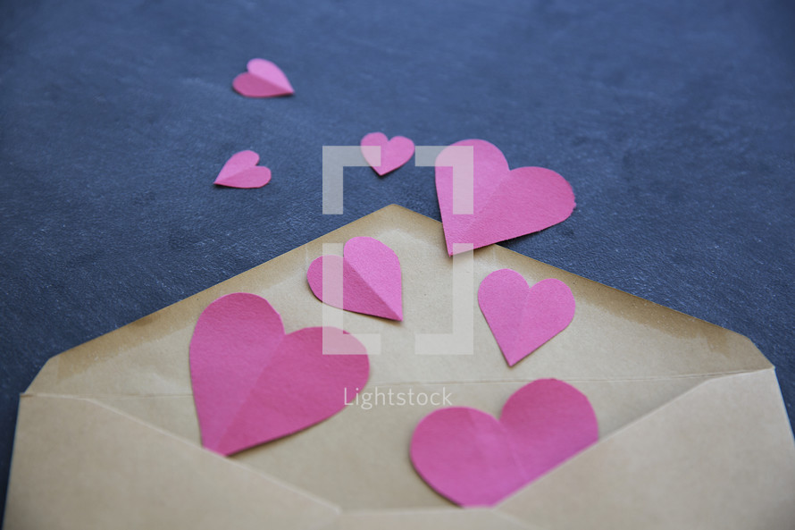 paper hearts in an envelope