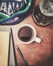 Seahawks, hat, pen, coffee, mug, pot, journal, notebooks, wood table