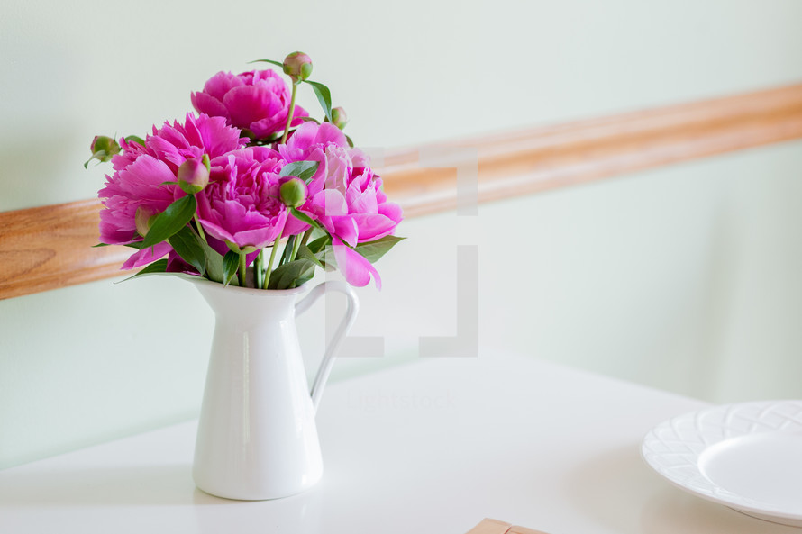 flowers in a pitcher on a table