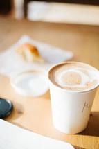 cappuccino and bread on a napkin
