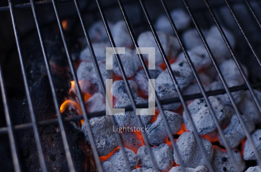 hot coals in a grill