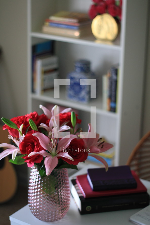 flowers in a vase and notebook and Bible