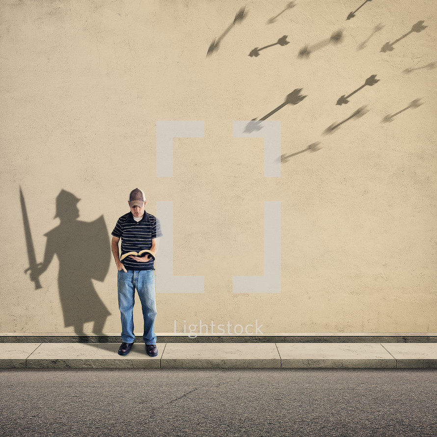 a man reading a Bible and shadows of a knight and shield with arrows flying