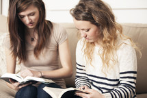 Friends reading Bibles together.