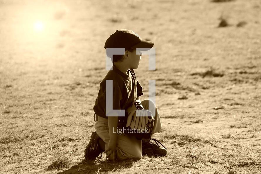 child playing tee ball