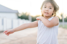 a child scratching her arm