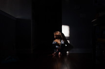 sky scared child sitting in a dark room