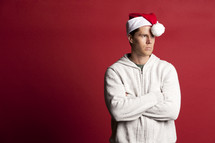 man in a santa hat pouting