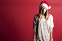 angry woman in a santa hat