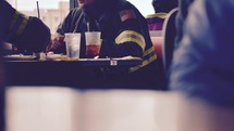 firefighters eating in a cafe