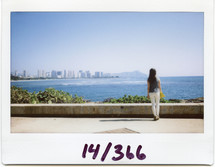 Polaroid of a woman standing at the shore