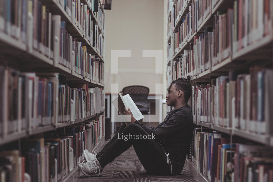 a student reading in a library